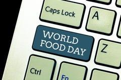 Het schrijven nota die de Dag van het Wereldvoedsel tonen De dag van de bedrijfsfoto demonstratiewereld van actie gewijd aan het  stock foto's
