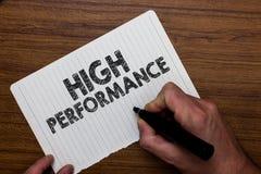 Het schrijven nota die Hoge Prestaties tonen De ontwikkeling die van de bedrijfsfoto demonstratieorganisatie teams of virtuele gr royalty-vrije stock afbeeldingen