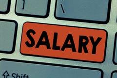 Het schrijven nota die Salaris tonen Bedrijfsfoto die vaste regelmatige betalings typisch betaald maandelijkse basis voor vast de royalty-vrije stock foto's