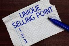 Het schrijven nota die Uniek Verkopend Punt tonen De bedrijfsfoto demonstratie onderscheidt van een Product Specifiek Eigenschapp stock foto