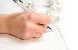 Het schrijven in notitieboekje Royalty-vrije Stock Afbeelding
