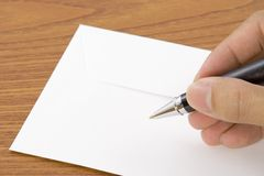 Het schrijven op een envelop stock afbeeldingen
