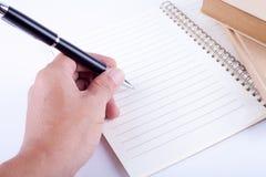 Het schrijven op het notitieboekje Royalty-vrije Stock Foto