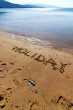 Het schrijven op het zand royalty-vrije stock afbeeldingen