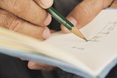 Het schrijven op sketchbook stock foto's