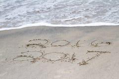 Het schrijven op zand Stock Foto's