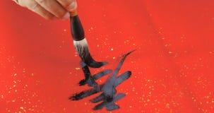Het schrijven van Chinese kalligrafie voor maan nieuw jaar, woordbetekenis van royalty-vrije stock afbeeldingen