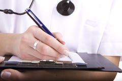 Het schrijven van de arts. Het digitale Ziekenhuis Stock Foto's