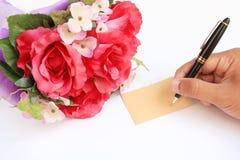 Het schrijven van de hand de kaart en nam toe Stock Fotografie