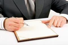 Het schrijven van de zakenman Stock Afbeelding