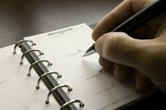 Het schrijven van een benoeming Stock Foto