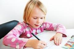 Het schrijven van het kind Stock Foto's