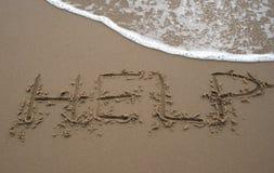 Het schrijven van het zand - HULP 2 Royalty-vrije Stock Afbeeldingen
