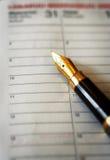 Het schrijven van notitieboekje Stock Foto's
