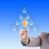 Het selecteren van een Vrouwelijke werknemer in een Piramide van Mannetjes Stock Foto