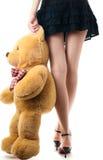Het sexy meisje met stuk speelgoed draagt Stock Afbeelding