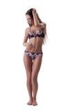 Het sexy meisje toont perfect lichaam in schoonheidslingerie Royalty-vrije Stock Afbeeldingen