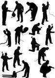 Het silhouet van de arbeider Stock Foto's
