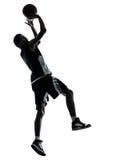 Het silhouet van de basketbalspeler Stock Afbeeldingen