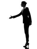 Het silhouet van de bedrijfsvrouwenhanddruk stock foto
