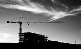 Het silhouet van de bouwkraan Stock Foto
