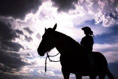 Het Silhouet van de cowboy Stock Afbeeldingen