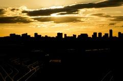 Het silhouet van de de stadshorizon van Birmingham bij zonsondergang Stock Foto