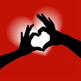 Het silhouet van de de vormhand van de liefde Stock Foto's