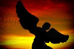 Het silhouet van de engel stock foto's
