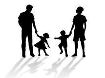 Het silhouet van de familie Stock Afbeeldingen