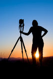 Het silhouet van de fotograaf Stock Afbeelding
