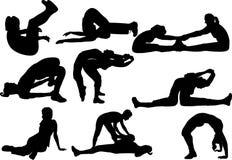 Het silhouet van de geschiktheid en van de yoga Stock Foto's