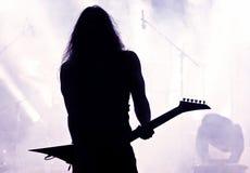 Het silhouet van de gitarist Stock Fotografie