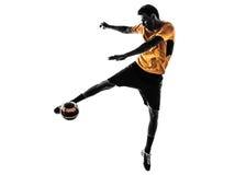 Het silhouet van de jonge mensenvoetballer Stock Afbeelding