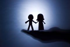 Het silhouet van de kinderverzorging. stock fotografie