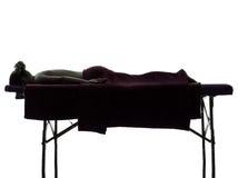Het silhouet van de massagetherapeut Stock Foto's