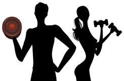Het silhouet van de mens en van het meisje Stock Foto's