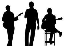 Het silhouet van de musicus Stock Foto