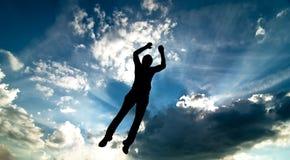 Het silhouet van de sprong Stock Foto's