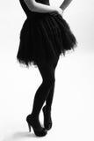 Het silhouet van de vrouw Stock Foto's