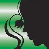 Het silhouet van de vrouw en van de bloem Stock Foto's