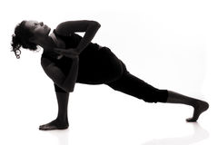 Het silhouet van de yoga stock afbeeldingen