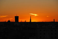 Het silhouet van de zonsondergang van stad Stock Fotografie
