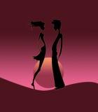 Het silhouet van het paar op zonsopgang Stock Fotografie