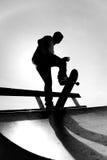Het Silhouet van Skateboarder Stock Foto