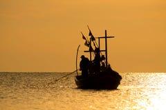 Het silhouet van Thaise visser Stock Fotografie