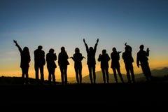 Het silhouet van vriendengroepen Stock Fotografie