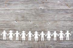 Het silhouet van Witboekkinderen op bruine houten achtergrond royalty-vrije stock foto's