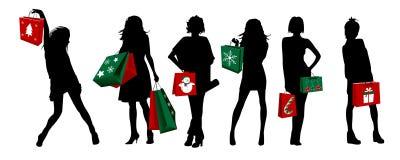 Het silhouetmeisjes van Kerstmis het winkelen Stock Afbeelding