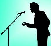 Het silhouettoespraak van de mens aan microfoon Stock Foto's